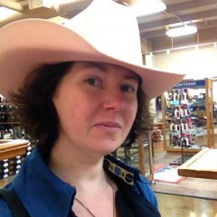 At a western store falling slightly in love with a pink cowboy hat.